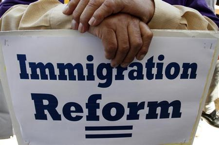 A man holds a protest sign during a rally for immigration reform in Los Angeles, California